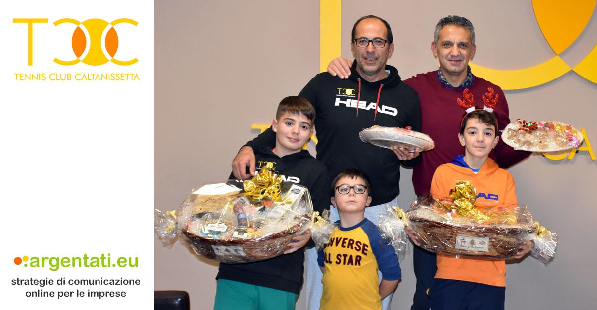 I finalisti del torneo: Antonio e Rosario Carrara (a sinistra, con il piccolo Leonardo), Paolo e Nino Argentati (a destra).